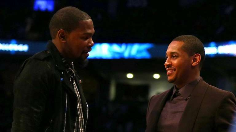 Kevin Durant, left, and Carmelo Anthony speak on