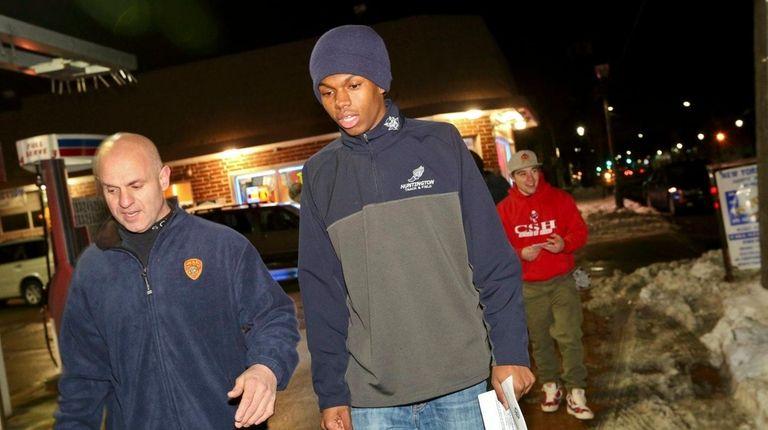 Kyree Johnson, right, of Huntington Station, walks with