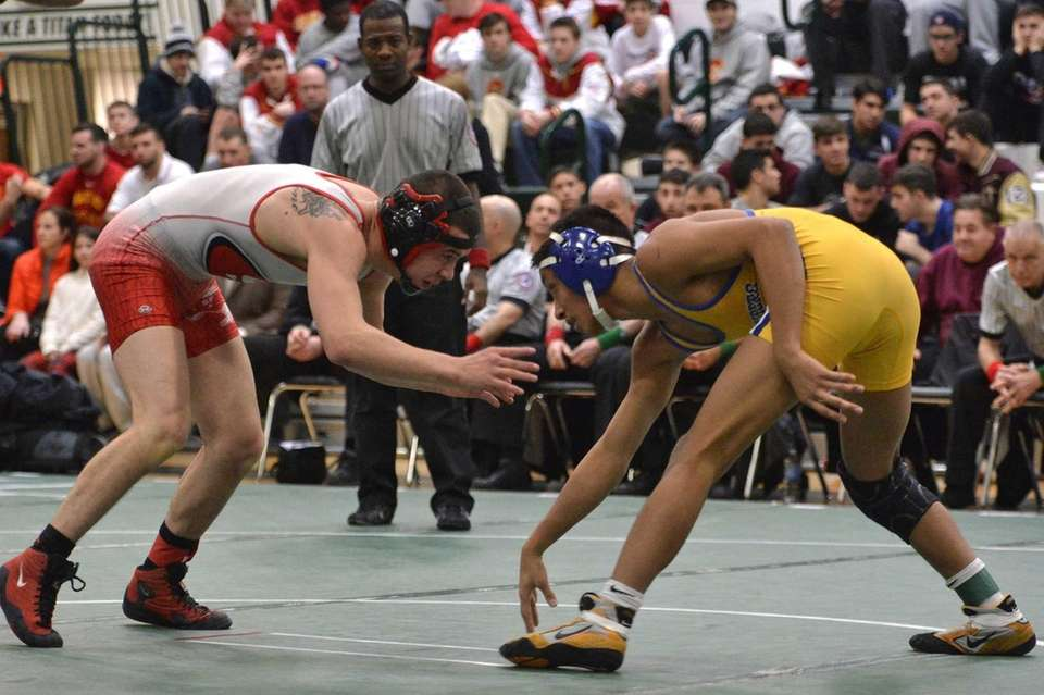 Kellenberg's Jason Javier takes on Saint Francis' Tito