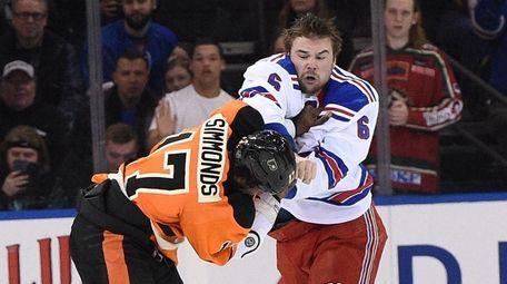 New York Rangers defenseman Dylan McIlrath fights with