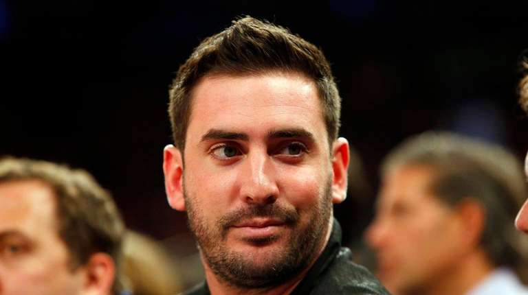 Matt Harvey of the Mets attends a game