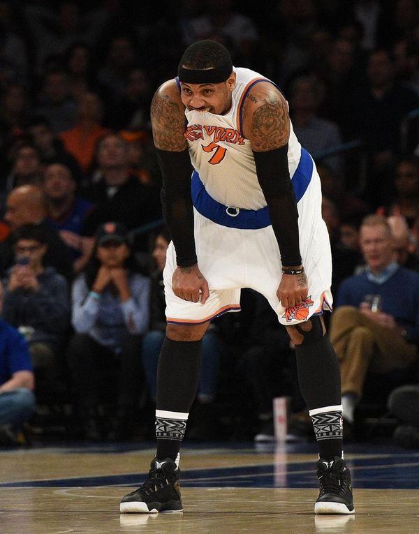 New York Knicks forward Carmelo Anthony looks on