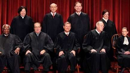 The Supreme Court justices pose for a group