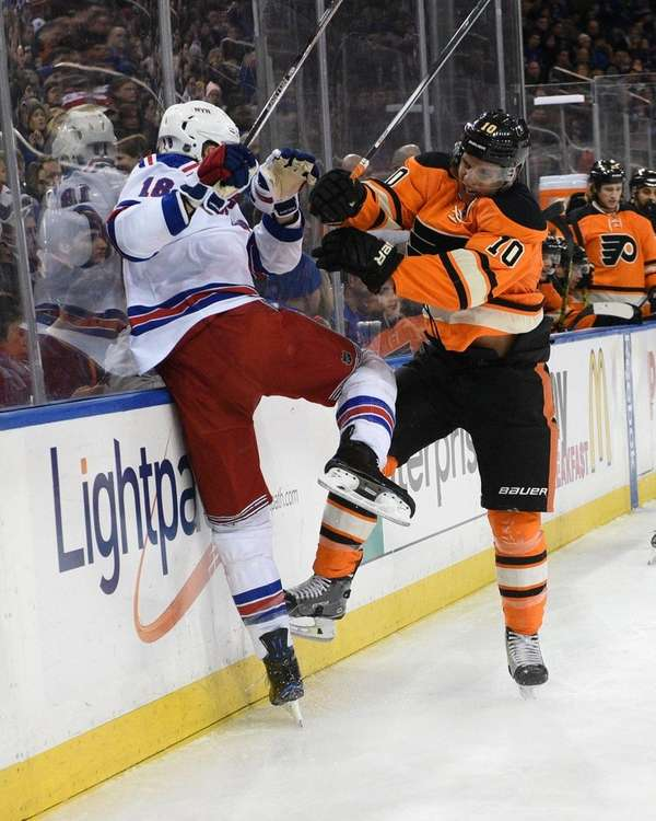 Philadelphia Flyers center Brayden Schenn checks New