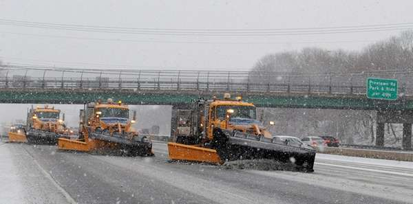 A line of snowplows on the eastbound LIE