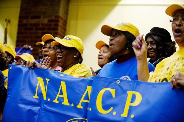 Local NAACP members cheer the announcement that Cornell