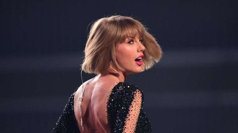 Taylor Swift performs during the 58th annual Grammy