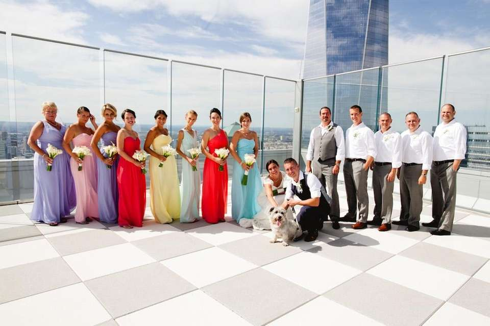 The wedding party and Dog of Honor posing
