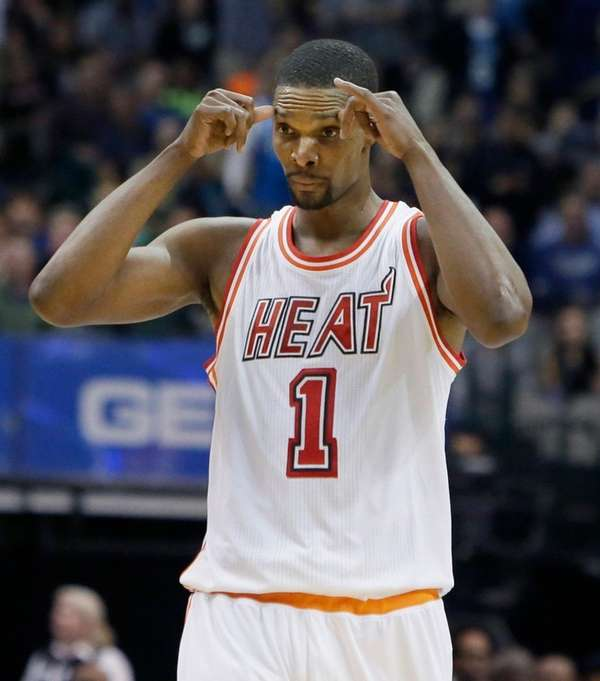Miami Heat forward Chris Bosh reacts to a