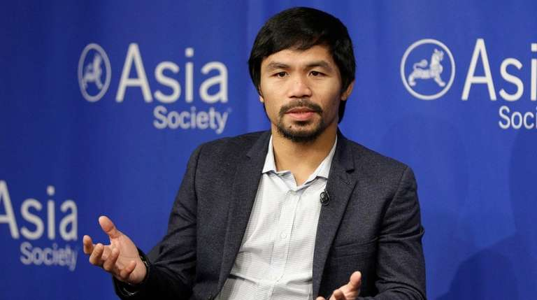 Manny Pacquiao takes questions at the Asia