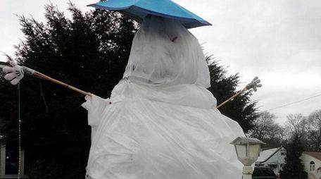 The 14-foot snowman outside the Massapequa Park home
