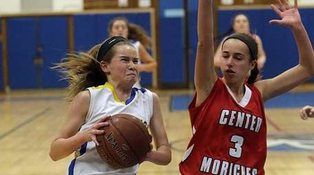 Mattituck's Mackenzie Daly drives into the paint against