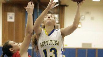 Mattituck's Liz Dwyer (13) gets off the layup