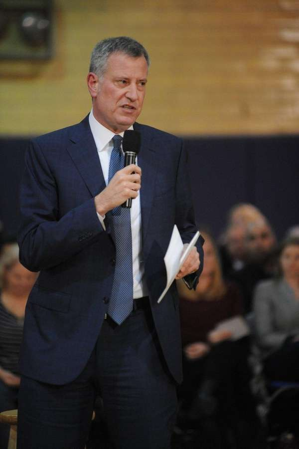 Mayor Bill de Blasio tells an audience at