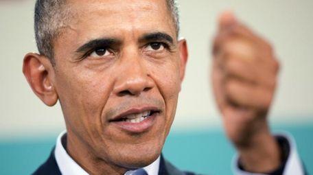 President Barack Obama gestures at a news conference