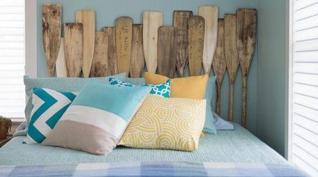 View of a guest bedroom featuring oar headboard