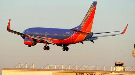A Southwest Airlines jet lands on March 16,