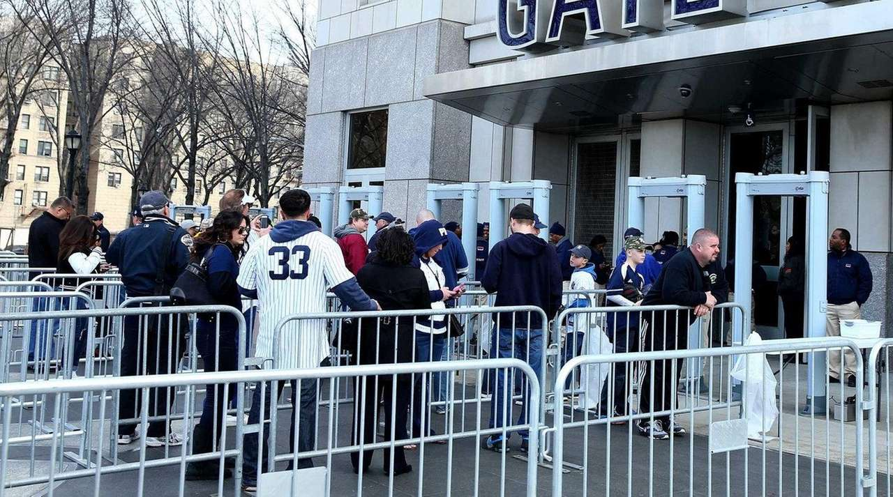 Fans line up to enter before the game