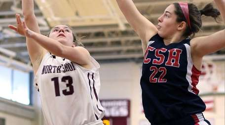 North Shore's Gabrielle Zaffiro tries to shoot over