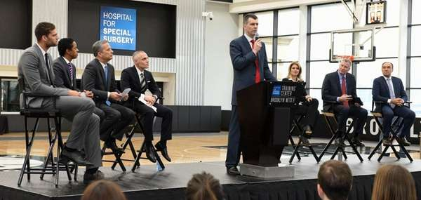 Nets owner Mikhail Prokhorov speaks while (to his