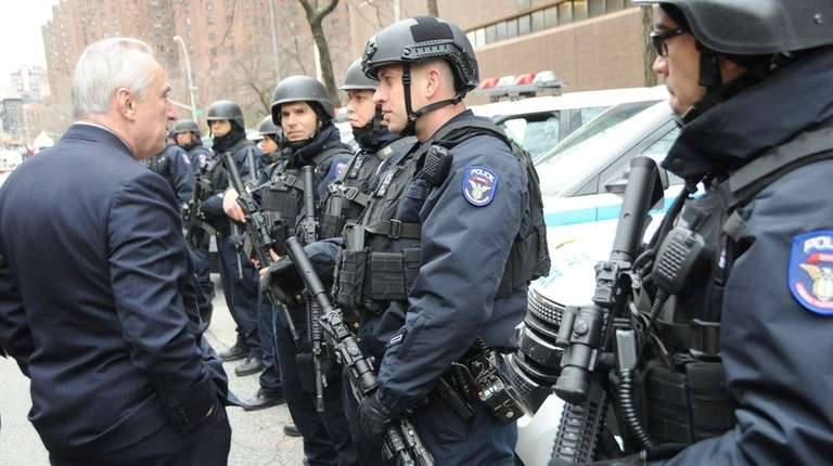 NYPD Commissioner William Bratton inspects the terror task