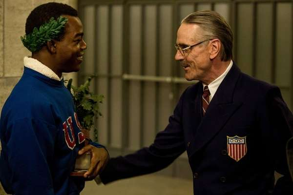 Stephan James, left, as Jesse Owens and Jeremy