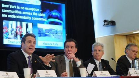 Gov. Andrew M. Cuomo, far left, discusses groundwater