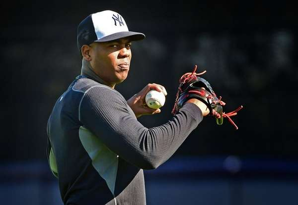 New York Yankees' Aroldis Chapman works out during
