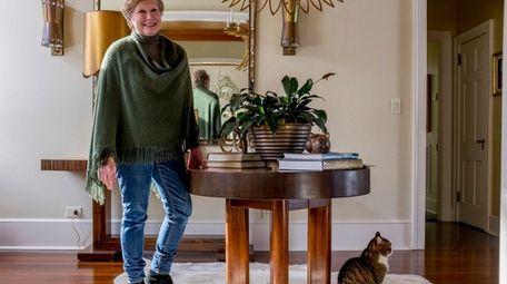 Interior designer Elizabeth Hagins with her cat, Kitty,