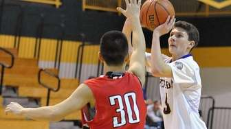 Kyle Schindler of Oyster Bay shoots a contested
