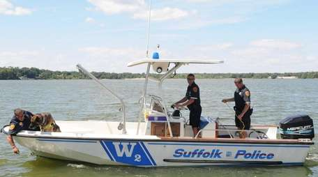 A Suffolk County police marine boat with a