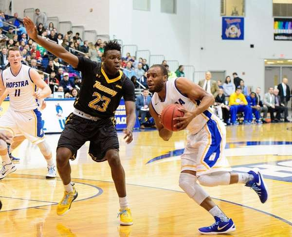 Hofstra's Juan'ya Green drives on Towson's Mike Morsell