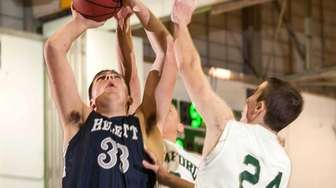 Hewlett's Zach Bromfeld shoots against Seaford's Keith Mcltugh