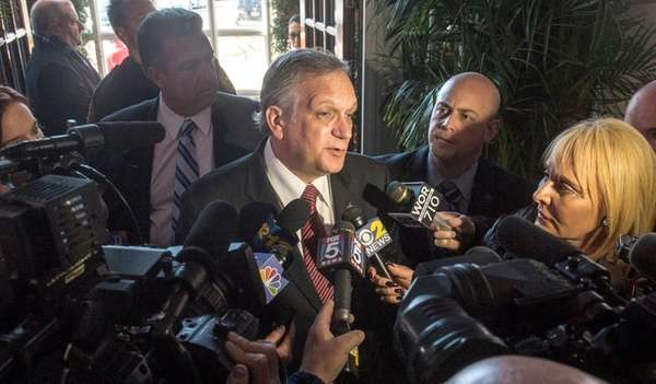 Nassau County Executive Edward Mangano is surrounded by