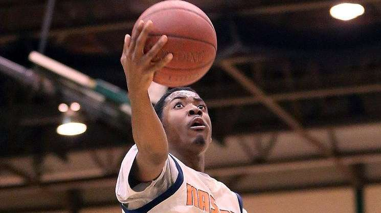 Nassau Community College's Marc Campbell soars for a
