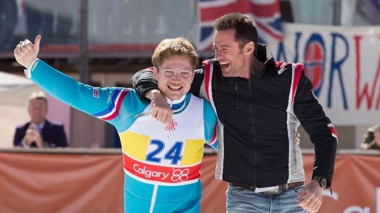 Eddie (Taron Egerton) and his coach Bronson Peary