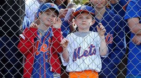 Fans watch as the New York Mets take