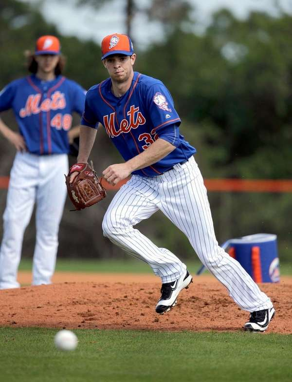 New York Mets pitcher Steven Matz chases a