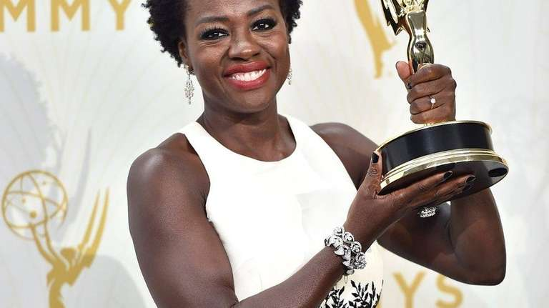 Viola Davis poses in the press room with