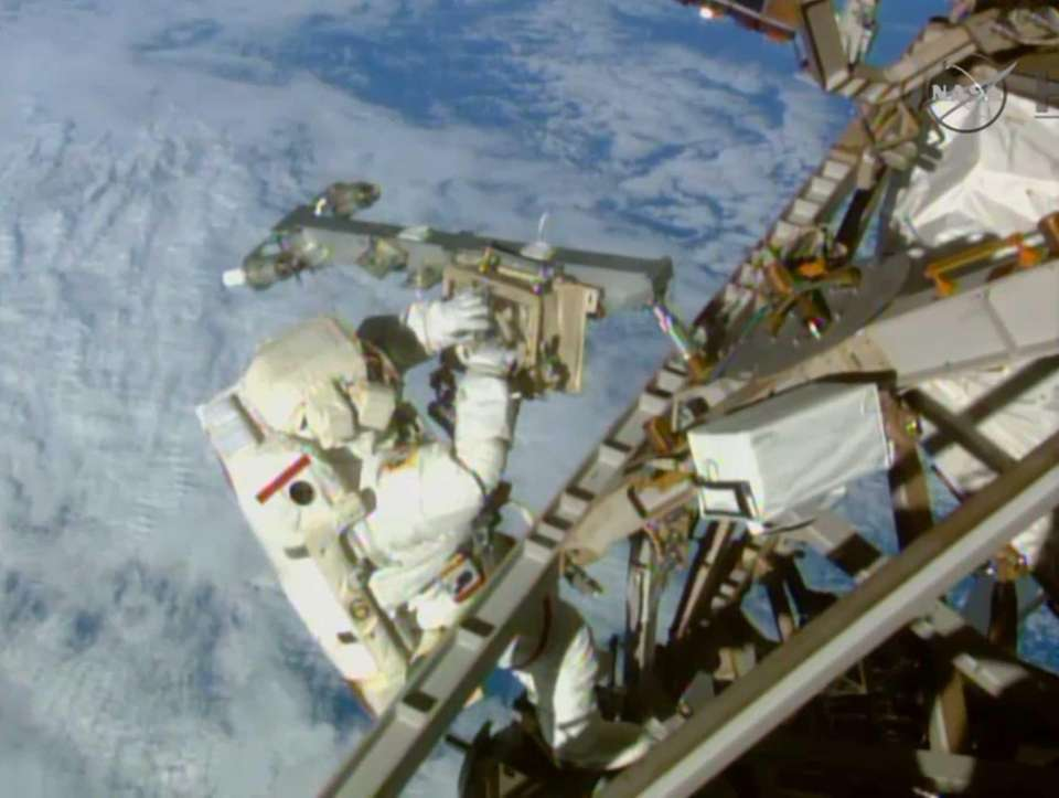 Astronaut Terry Virts installs an antenna and boom