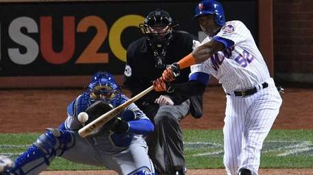 Yoenis Cespedes singles during Game 3 of the