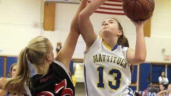 Mattituck forward Liz Dwyer drives against Pierson guard