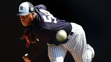 New York Yankees pitcher Aroldis Chapman throws during