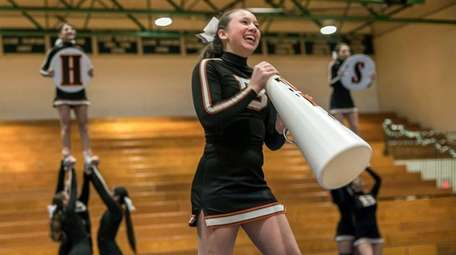 Babylon's Meghan Greene cheers during the Suffolk Cheerleading