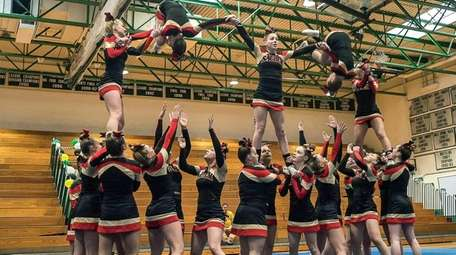 Sachem East performs a stunt during the Suffolk