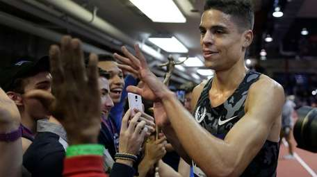 Matt Centrowitz, right, greets track and field fans