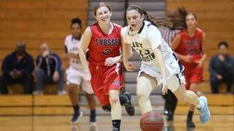 Baldwin's Jenna Annecchiarico dribbles up court while being