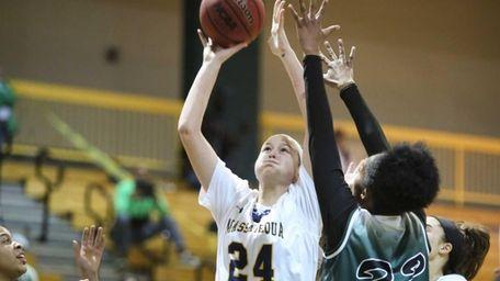 Massapequa's Melanie Hingher, left, puts the ball up