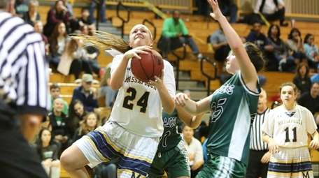 Massapequa's Melanie Hingher goes up with the ball,