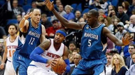 New York Knicks' Carmelo Anthony, center, is double-teamed